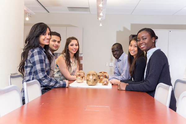 Bio Program students smiling around a table