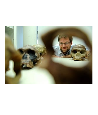 Professor Bence Viola with a Collection of Skulls